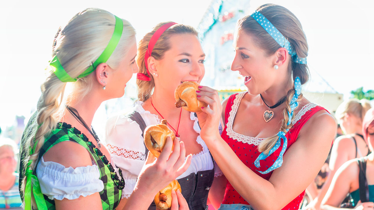 Three girls eating sausages in roll.jpg